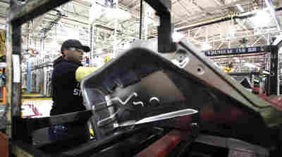 A worker is shown last month at the Fiat Chrysler Automobiles' Warren Stamping Plant in Warren, Mich.