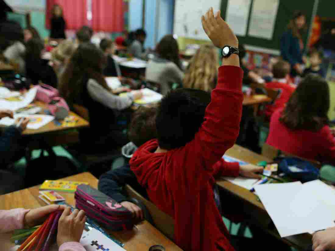Children attend a lesson in a classroom of a primary school, in Cherbourg-Octeville, northwestern France.