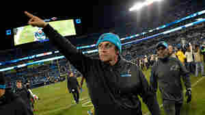 Carolina Panthers head coach Ron Rivera salutes the fans as he leaves the field after a win against the Tampa Bay Buccaneers on Jan. 3, 2016 in Charlotte, North Carolina.