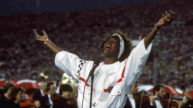 Whitney Houston sings the National Anthem before Super Bowl XXV — the New York Giants against the Buffalo Bills — at Tampa Stadium on January 27, 1991. The Giants won 20-19.