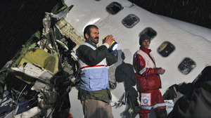 Rescue workers look through the wreckage of an Iran Air Boeing 727 plane that crashed in northwest Iran as it was making an emergency landing in 2011. More than 70 of the 106 on board were killed. Iran's aging airline fleet has had a poor safety record.