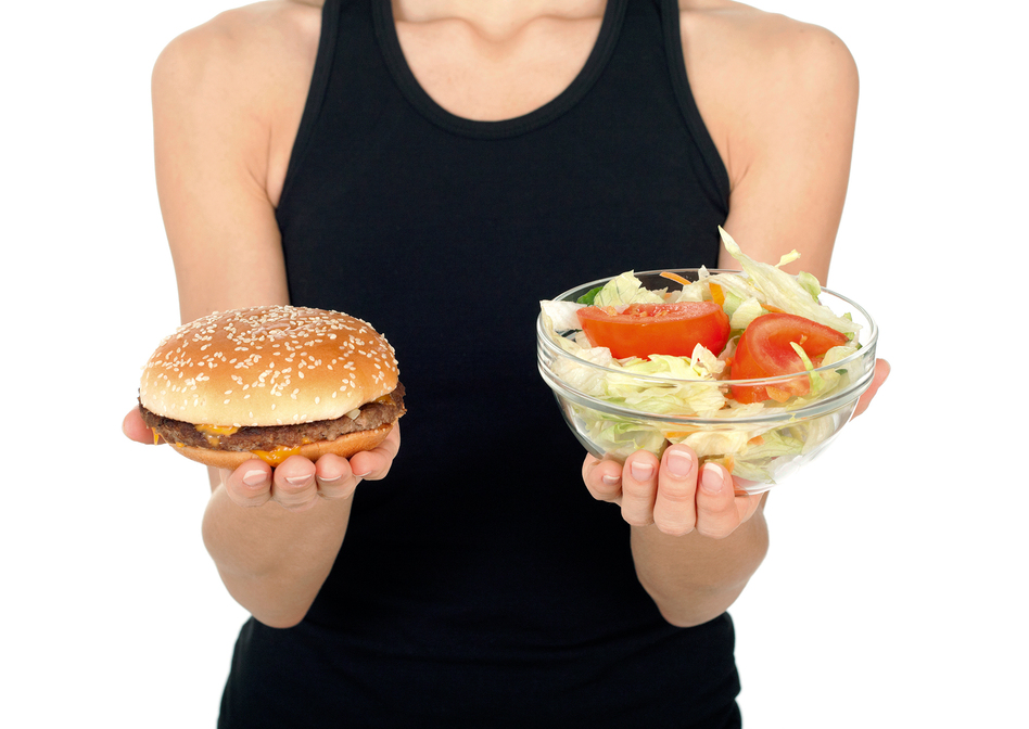 There may be growing chorus of veggie cheerleaders, but don't assume most Americans are choosing salad over hamburgers. (iStockphoto)