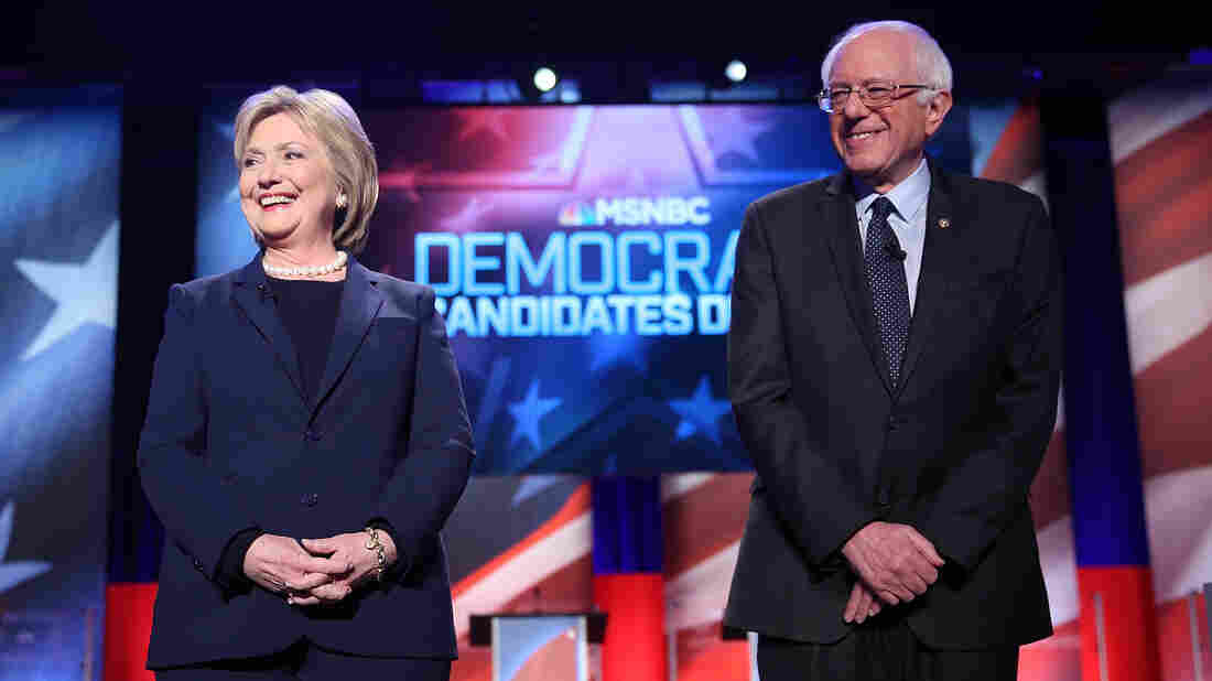 Hillary Clinton and Bernie Sanders stand next to each other at the start of the MSNBC Democratic Candidates Debate Feb. 4, in Durham, N.H.