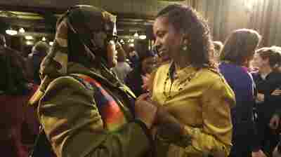 Former Wheaton College professor Larycia Hawkins (right) is greeted by supporter Donna Demir after a news conference on Jan. 6 in Chicago. Hawkins, who's Christian, was suspended by Wheaton, an evangelical Christian school, after she said Muslims and Christians worship the same God. Administrators initiated steps to fire her. On Saturday the professor and school announced they'd parted ways.