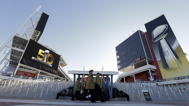 Workers arrive at Levi's Stadium in Santa Clara, Calif., on Sunday before the Super Bowl. (AP)