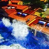 High tides crash into The Marine Room in La Jolla, Calif.