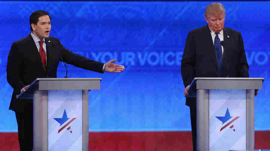 Republican presidential candidates Sen. Marco Rubio and Donald Trump participate in the Republican presidential debate at St. Anselm College Saturday in Manchester, N.H.