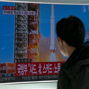 People watch a television screen showing breaking news on North Korea's long-range rocket launch on Sunday in Seoul, South Korea. Western experts consider the launch to be part of a program to develop intercontinental ballistic missile technologies, banned by multiple U. N. Security Council resolutions against North Korea.