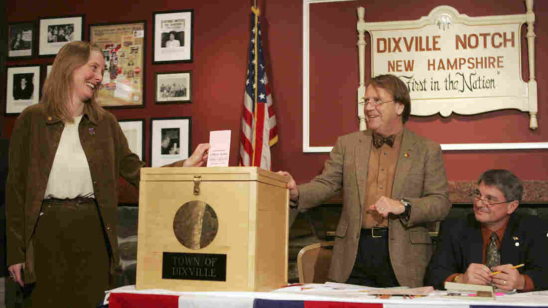 In Dixville Notch, N.H., in 2008, Tom Tillotson (center) watches as Donna Kaye Erwin casts the first ballot for the nation's first primary. That year, the tiny town picked Barack Obama over Hillary Clinton, 7-2; but Clinton went on to win the state primary.