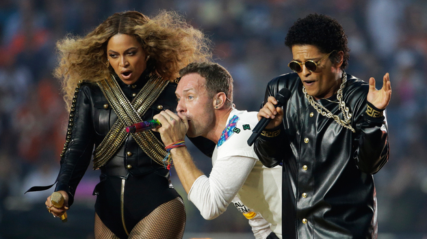 Beyoncé, Coldplay singer Chris Martin and Bruno Mars perform during halftime of the NFL Super Bowl 50 football game Sunday, Feb. 7, 2016, in Santa Clara, Calif. (AP)
