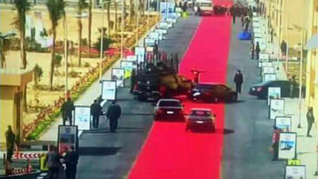 Egyptian President Abdel-Fattah al-Sisi's motorcade drives on a red carpet during a trip to open a social housing project in a suburb of Cairo on Saturday. One local newspaper devoted its entire front page Monday to accusing Sisi of decadence even as he asks Egyptians to tighten their belts. (AP)