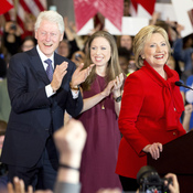 Hillary Clinton, accompanied by her husband, former President Bill Clinton, and their daughter Chelsea Clinton during a campaign event this year.