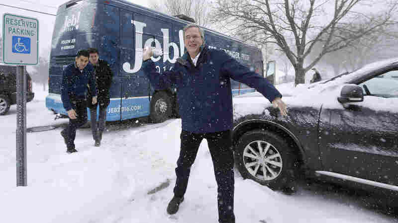 Jeb Bush throws a snowball following a campaign event Monday in Nashua, N.H.