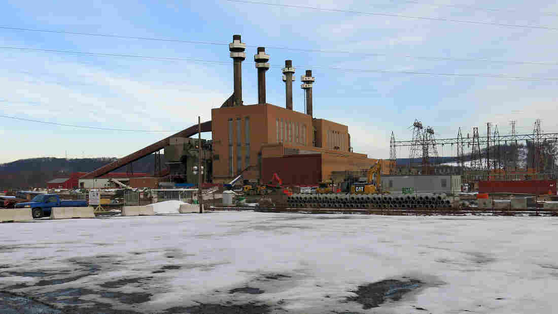 The coal plant in Shamokin Dam, Pa., is a local landmark that delivered electricity to this region for more than six decades. It closed in 2014. Next to it, a brand new natural gas power plant is under construction.