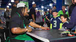 Seattle Seahawks running back Marshawn Lynch speaks to young fans at a store in Bellevue, Wash., in November.