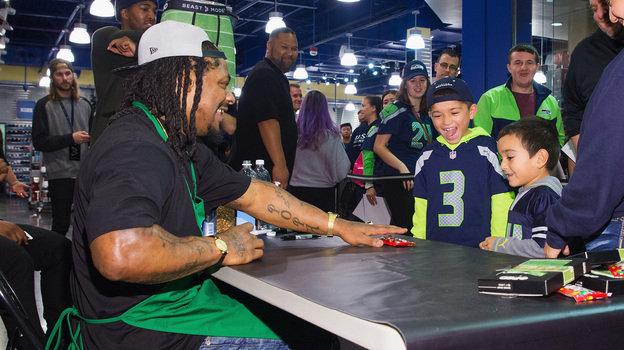 Seattle Seahawks running back Marshawn Lynch speaks to young fans at a store in Bellevue, Wash., in November. (Getty Images)