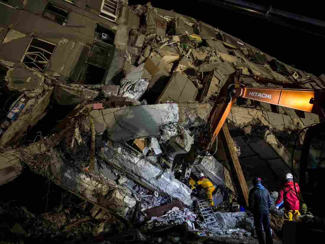 Rescue workers in the southern Taiwanese city of Tainan look for survivors in the rubble of a building that collapsed in the 6.4-magnitude earthquake.