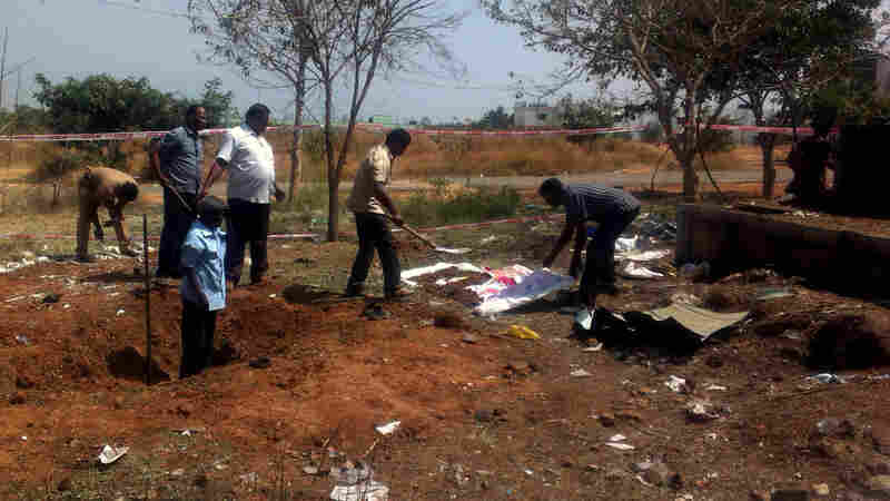 Indian authorities inspect a crater left by a suspected meteorite in southern Tamil Nadu state. Local officials say the impact killed a bus driver and injured three others on Feb. 6.