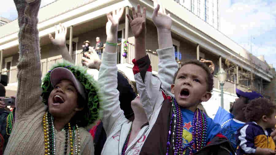 Revelers celebrate Mardi Gras in Mobile, Ala., in 2010.