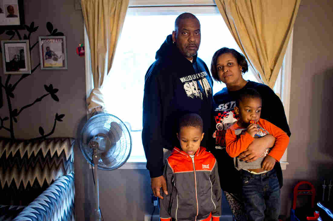 Earl and Jeneyah McDonald pose for a portrait with their sons Justice, 6, and Josiah, 2, at their home in Flint. The McDonalds have had to teach their sons that the water is poison and not to go near it or use it.