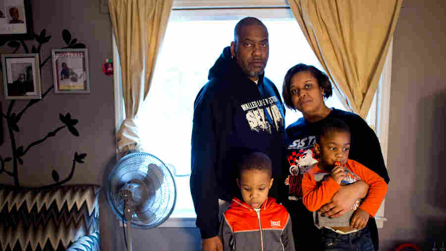 Earl and Jeneyah McDonald with their sons Justice, 6, and Josiah, 2, at their home in Flint, Mich. The McDonalds have had to teach their sons that the water is poison and not to go near it or use it.