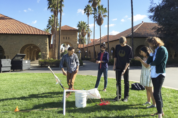 Students prepare a rocket launch for a science class on the campus of Stanford University in Palo Alto, Calif.