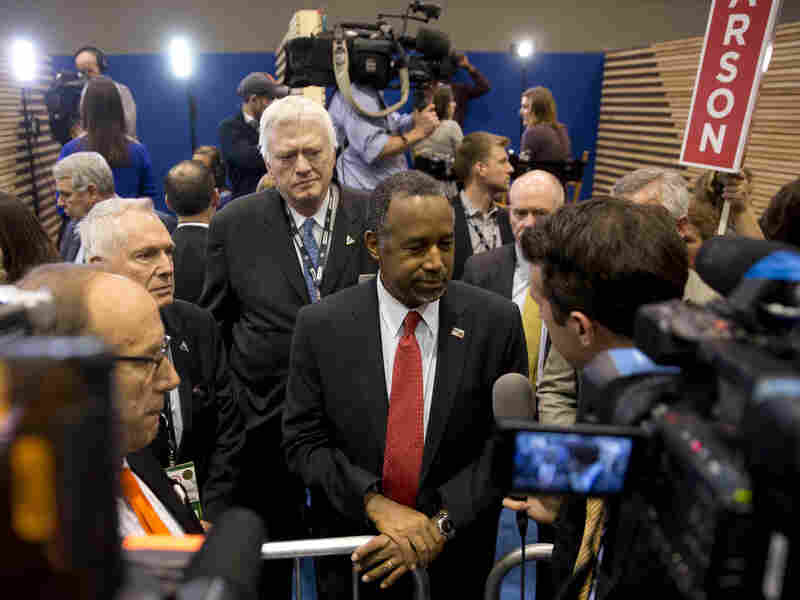 Republican presidential candidate Dr. Ben Carson speaks with members of the media after the GOP debate Saturday.