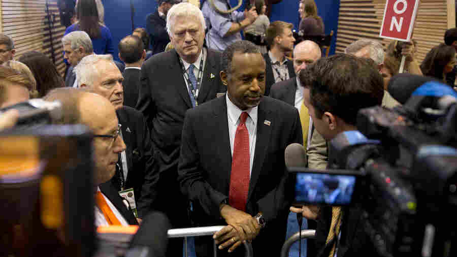 Republican presidential candidate, Dr. Ben Carson speaks with members to the media after the GOP debate Saturday.