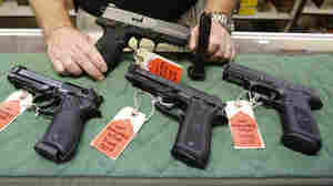 West Virginia's House of Delegates has approved a bill repealing permit requirements for carrying a concealed gun. Here, a file photo shows a display of pistols at a gun shop in 2013.