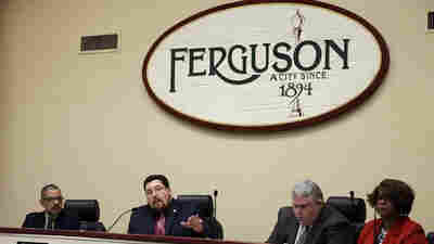 Ferguson Mayor James Knowles III speaks during a City Council meeting last week. The meeting was the first opportunity for residents to speak directly with city leaders about the preliminary consent agreement with the Department of Justice.