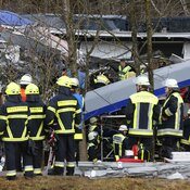 Rescue personnel stand in front of two trains that collided head-on near Bad Aibling, in southern Germany, Tuesday.