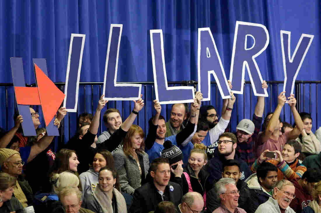 Supporters of Hillary Clinton hold signs spelling out her name at her New Hampshire primary campaign rally in Hooksett, N.H.