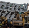 Rescue workers are using heavy equipment to look for survivors trapped in a building that collapsed in a 6.4 magnitude earthquake in the southern Taiwanese city of Tainan.