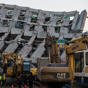 Rescue workers used heavy equipment to look for survivors trapped in a building that collapsed in a magnitude-6.4 earthquake in the southern Taiwanese city of Tainan.
