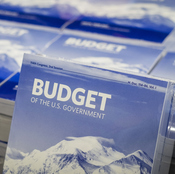 Copies of President Obama's budget sit on a table in the Senate Budget Committee room.