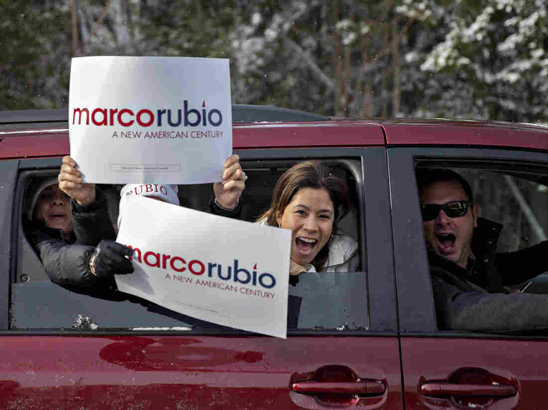 Rubio supporters yell from a car window while driving outside a polling station in Bedford, N.H., on Tuesday.