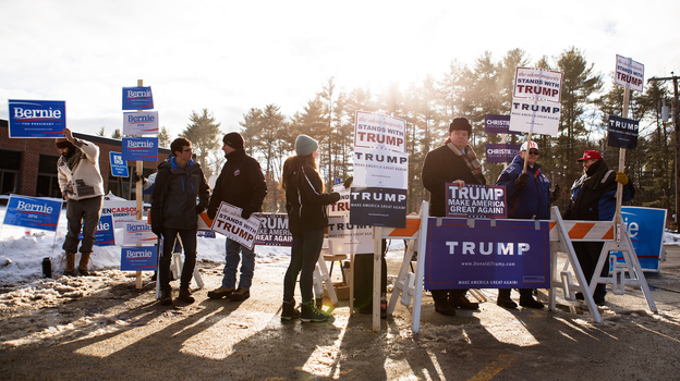 Supporters rally for their candidates outside of the voting place at Merrimack High School in Merrimack, N.H., for Tuesday's primary. (Getty Images)