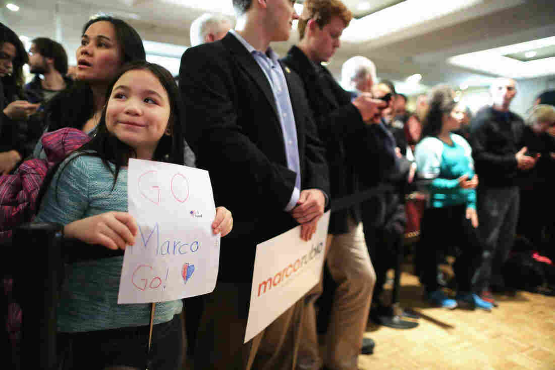 Jaeden Walls, 8, waits for the arrival of Republican presidential candidate Marco Rubio with a sign of support she made for the senator during a primary night party at the Radisson Hotel in Manchester, N.H.