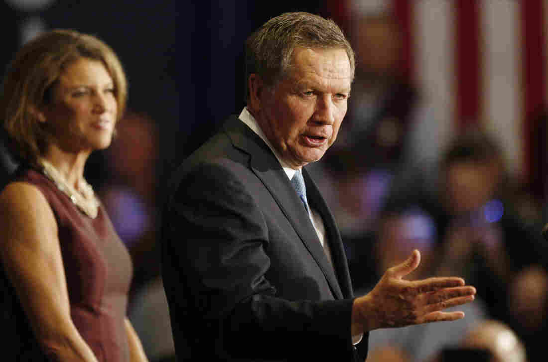 Ohio Gov. and Republican presidential candidate John Kasich, joined by his wife, Karen, speaks to supporters during a primary election watch party after finishing second to Donald Trump.