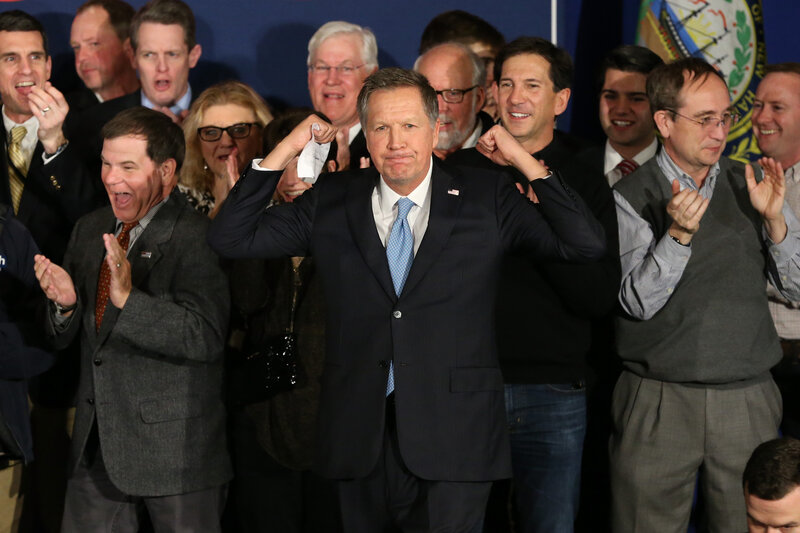 Republican presidential candidate Ohio Governor John Kasich arrives on stage at a campaign gathering with supporters after placing second in the New Hampshire republican primary in Concord, N.H.