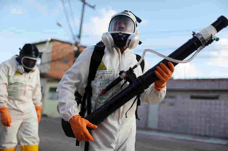 Health workers fumigate in an attempt to eradicate the mosquito which transmits the Zika virus on January 28, 2016 in Recife, Pernambuco state, Brazil. Two two-man teams were fumigating in the city today. Health officials believe as many as 100,000 people have been exposed to the Zika virus in Recife, although most never develop symptoms.