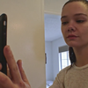 "A young woman snaps a selfie in a new video from the band Liima, for the song ""Amerika."""