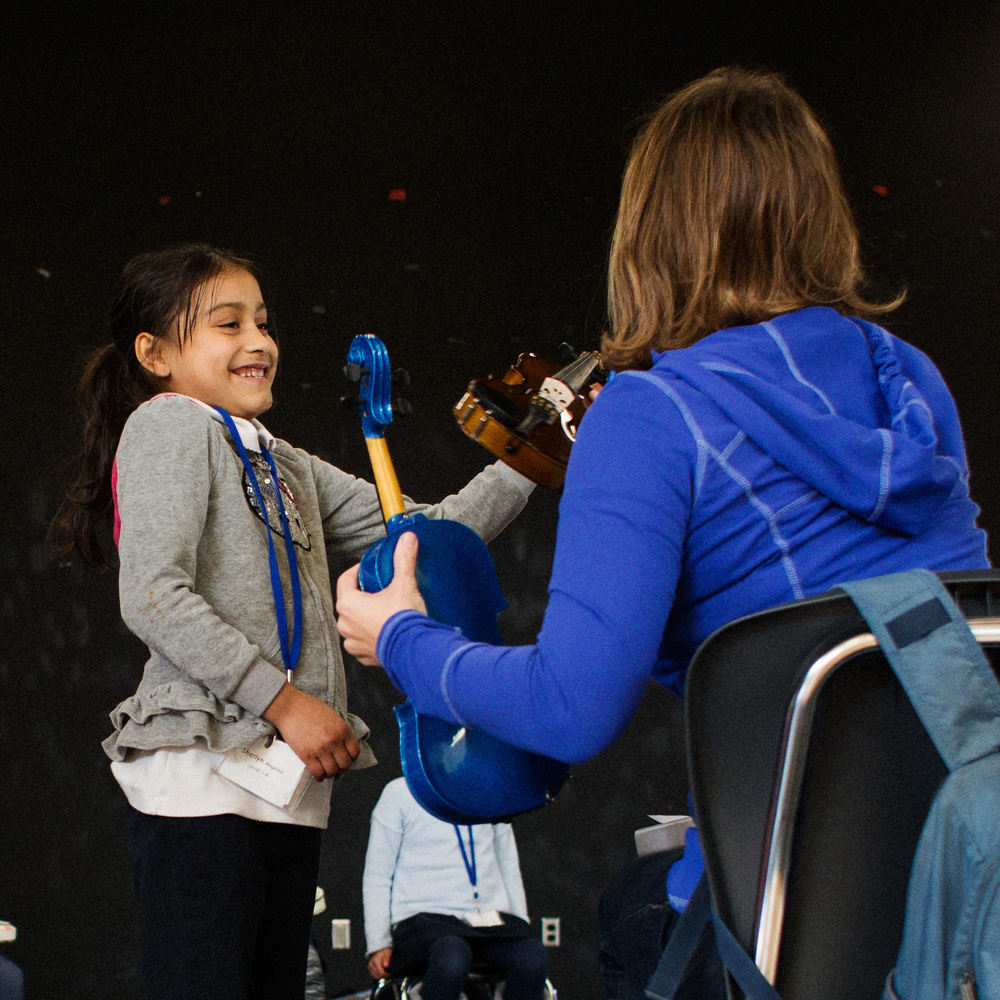 Students get fitted for violins at Downer Elementary School in San Pablo, Calif. The school offers a free music program called Sound Minds.