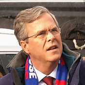 Republican presidential candidate, former Florida Gov. Jeb Bush speaks with voters outside of Webster Elementary School in Manchester, N.H. on Tuesday.