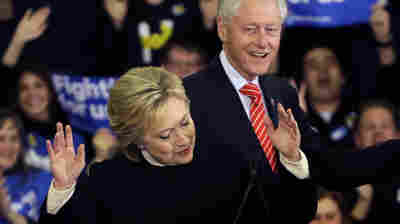 Democratic presidential candidate Hillary Clinton reacts as former President Bill Clinton smiles at her presidential primary campaign rally in Hooksett, N.H., on Tuesday.