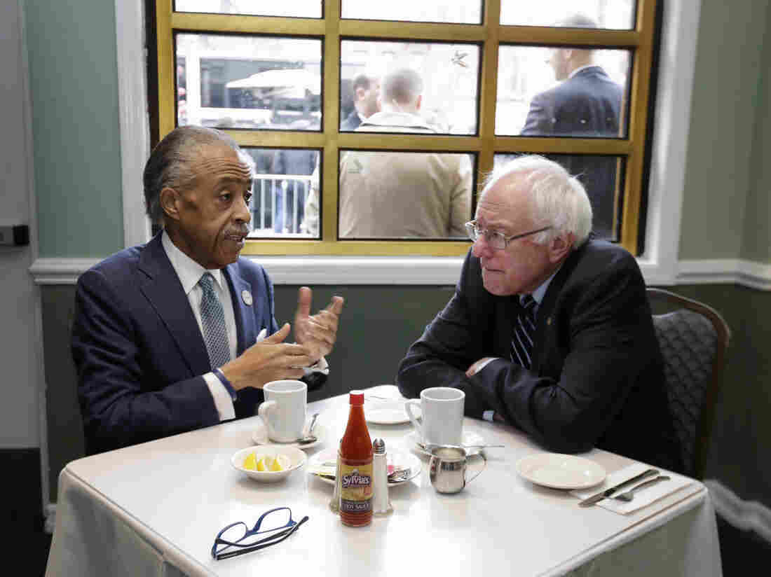 The Rev. Al Sharpton talks with Sen. Bernie Sanders at Sylvia's Restaurant in Harlem the morning after his New Hampshire primary victory over Hillary Clinton.