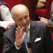 French Foreign Minister Laurent Fabius waves to members of parliament Wednesday during questions to the government session at the National Assembly in Paris.