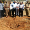 Indian authorities inspect the site of a suspected meteorite landing that killed a bus driver and injured three others on Feb. 6.