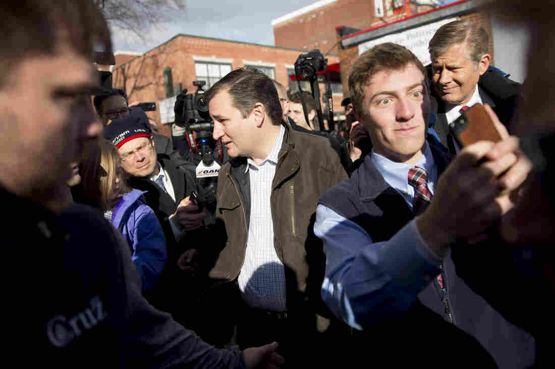 Texas Sen. Ted Cruz speaks to the media while leaving the Red Arrow Diner in Manchester.