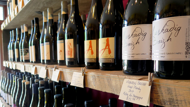 Bottles for sale at Passage de la Fleur, a natural wine shop in Brooklyn, N.Y. For some, natural wines must be completely unadulterated — without the use of sugar, clarifiers or other additives common in modern winemaking. Other natural winemakers, however, will use a little sulfur or added yeast to correct problems, according to Stephen Meuse, a wine buyer in Massachusetts. (Andrea Shea for NPR)